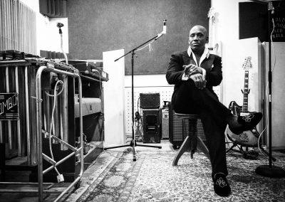Carlton Jumel Smith sitting in studio.